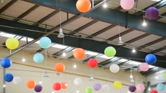 Colorful lantern lampions hanging on a ceiling during entertainment event Stock Footage