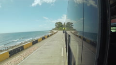 Sea view from the window of a moving bus Stock Footage