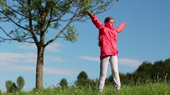 Girl make physical exercises on the nature near tree Stock Footage