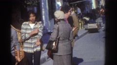 1976: dozens of people outdoors walking about on a busy city street ISRAEL Stock Footage