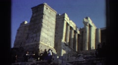 1976: people standing outside of ancient stone ruins atop a hill ISRAEL Stock Footage