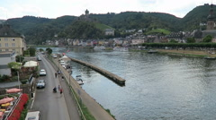 Cityscape of Cochem at Moselle river. People walking along the Promenade Stock Footage