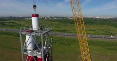 Workers on the top install pipe for gas power plant aerial shot Stock Footage