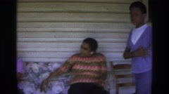 1975: family cooling off on a porch on a blistering hot day. ATLANTA GEORGIA Stock Footage