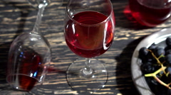 Close up bunch of Grapes , glass of red wine and bottle. Stock Footage