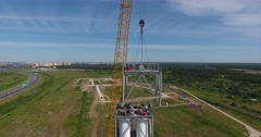 Workers on the top installing chimney pipe segment. Aerial shot Stock Footage