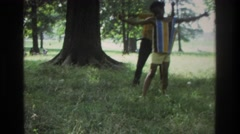 1975: two small boys dancing & enjoying on some song in garden. ATLANTA GEORGIA Stock Footage