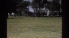 1975: man running through park by water tower ATLANTA GEORGIA Stock Footage