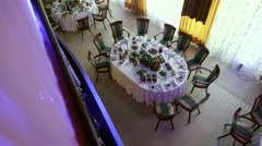 Decorated Banquet Hall awaits guests, view from the balcony Stock Footage