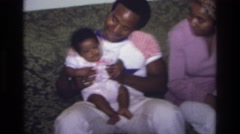 1975: man holding a baby ATLANTA GEORGIA Stock Footage