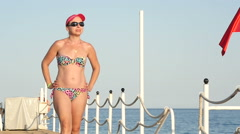 Pretty woman walking on the pier , slow motion 1 Stock Footage