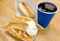 Fast Food, Delicious French Fries and Hot Dog Served with Soda Drink. Selecti Stock Photos