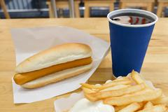 Fast Food, Delicious Hot Dog and French Fries Served with Soda Drink. Selecti Stock Photos