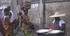 Woman peddler sells fabric in Accra Stock Footage