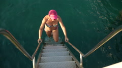 Pretty woman climbing stairs on the pier , slow motion  1 Stock Footage