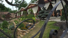 The garden with lots of plants, stairs and pergolas Stock Footage