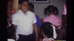1975: birthday party of children enjoying the festivities, dancing around  Stock Footage