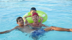 Mother with two sons swimming in a pool, slow motion 2 Stock Footage