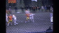 1975: watching a football game in action. BRONX NEW YORK Stock Footage