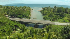 The river flows into the sea. Road bridge. Philippines. Bohol island Stock Footage