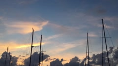 Timelapse: masts of sailing ships on a background of blue sky with clouds. Stock Footage