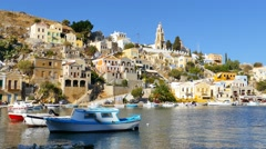 Symi island - Colorful houses and small boat footage at the heart of the village Stock Footage