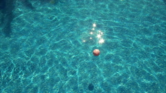 Beach ball floating in pool Stock Footage