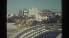 1976: panning from a residential skyline to a beach somewhere in greece GREECE Stock Footage