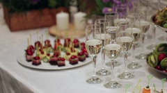 In poured a glass of champagne, the bubbles go up, a table decorated with Stock Footage