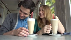 Young couple students lovers relaxing having fun drinking Coffee at cafe table Stock Footage