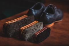 Kit of brushes with footwear Stock Photos