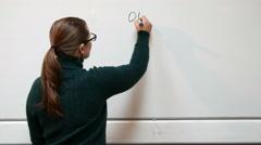 Chemistry teacher writing formula on the blackboard Stock Footage