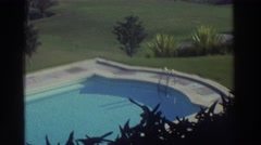 1976: formal swimming pool in a mediterranean valley with foliage hills  Stock Footage