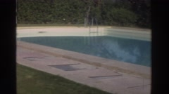 1976: woman relaxing at poolside on vacation. GREECE Stock Footage