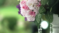 Wedding stand with yellow, white, pink and lavender flowers close up Stock Footage