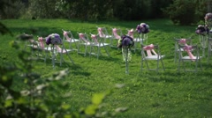 White chairs with pink bows and a wdding altar in white and lavender colors Stock Footage