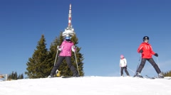 Young skiers wearing ski goggles and safety helmet skiing downhill in mountain Stock Footage