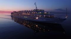Unique aerial flight around cruise ship. Beautiful sunset. No wind. Stock Footage
