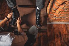 Shoes on a wooden shoe platform Stock Photos