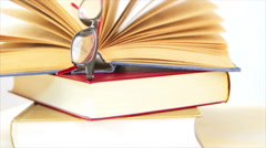 Falling eyeglasses from the books Stock Footage