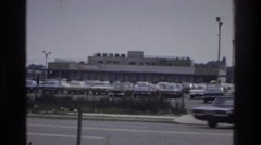 1975: view of the vehicles driving down the street. BRONX NEW YORK Stock Footage