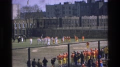 1975: football scene people cheering from behind fence area BRONX NEW YORK Stock Footage