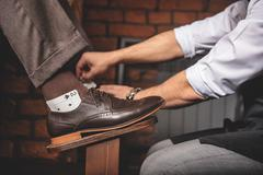 Playing cards in the pair of boots Stock Photos