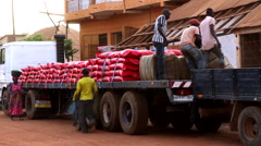 Caju vendor loading the truck in  in street city of Bisseau - Africa Stock Footage
