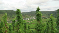 Driving along at vineyards of Moselle river. In background village Beilstein Stock Footage