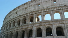ROME, ITALY - SEPTEMBER 4, 2016. Tourists walk next to the Colosseum in Rome Stock Footage