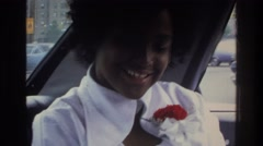 1975: a woman sitting in the backseat, talking and laughing. BRONX NEW YORK Stock Footage