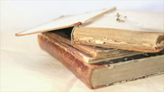 Open antique book and pince nez Arkistovideo