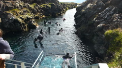 Snorkelers in the Silfra fissure, Iceland Arkistovideo