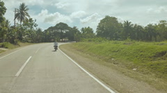 Village Road. Motion on motorbike. Philippines. Bohol island. Driving forward Stock Footage
